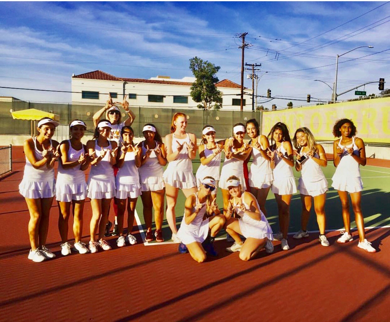 winning girls tennis team posing for photo