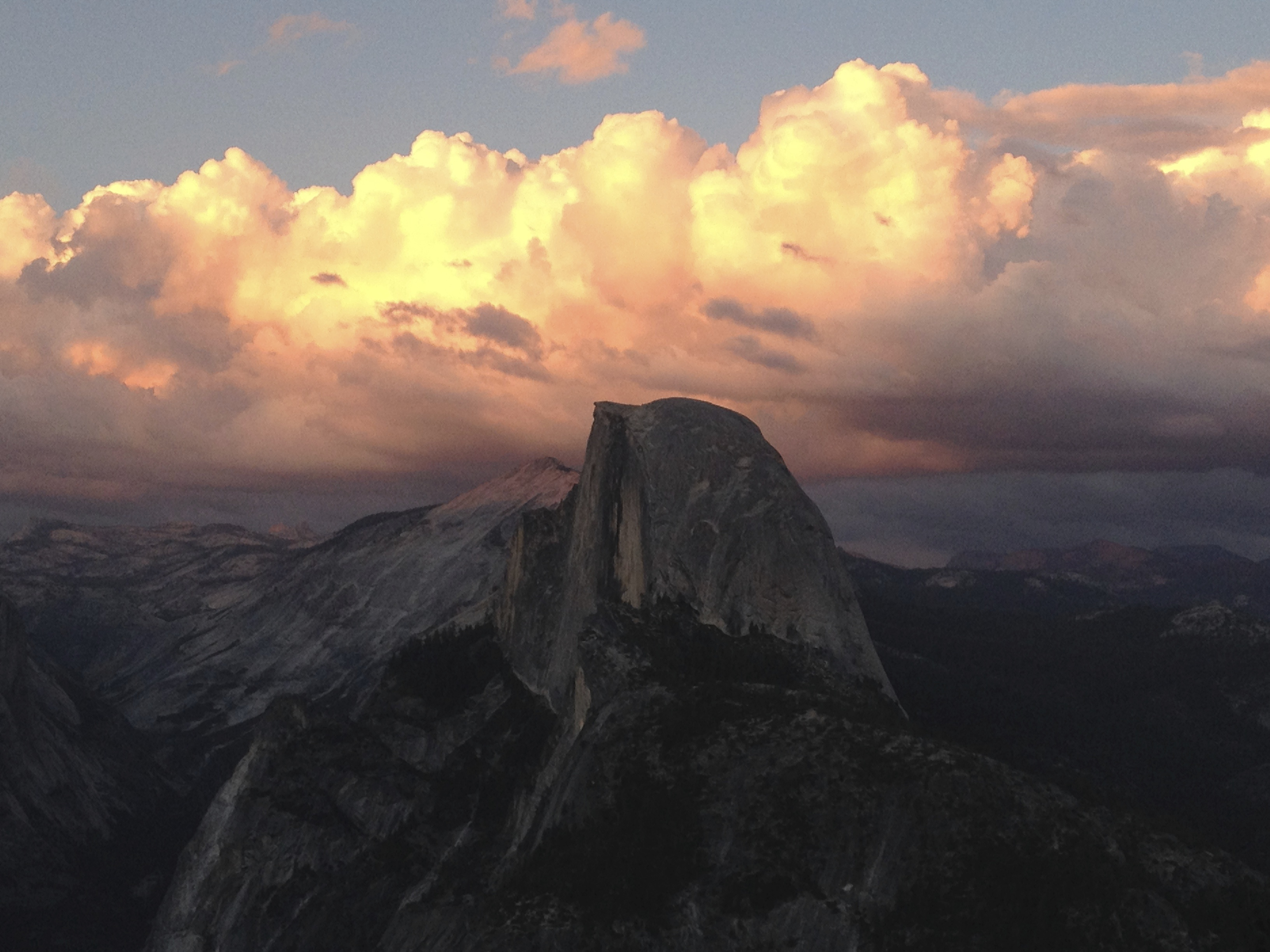 I took this photo of Half Dome in Yosemite at sunset. Half Dome is silhouetted  because the sun had already set, but the sky is full of color.