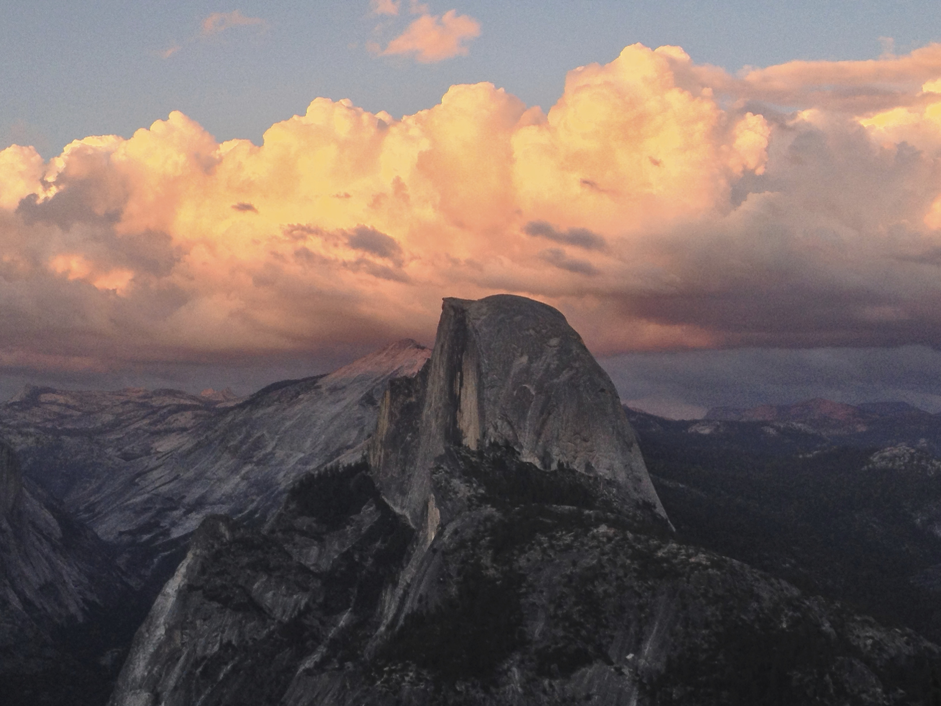 The second photo of Half Dome has better definition on Half Dome. You can see  details on the mountain, as well as, having the sky full of sunset colors.