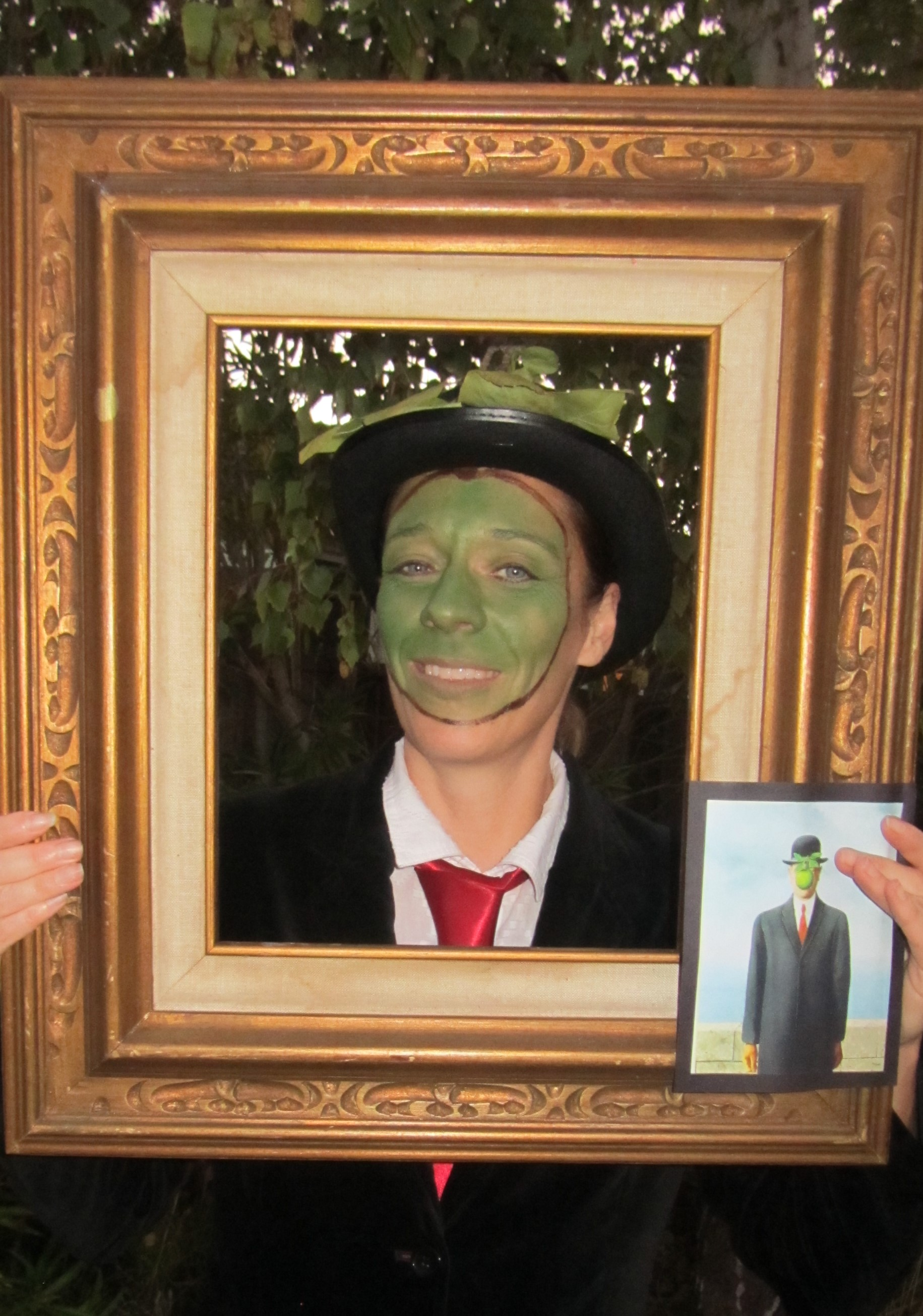 Halloween picture of Ms. Fordham as Magritte painting, Man in a Bowler Hat