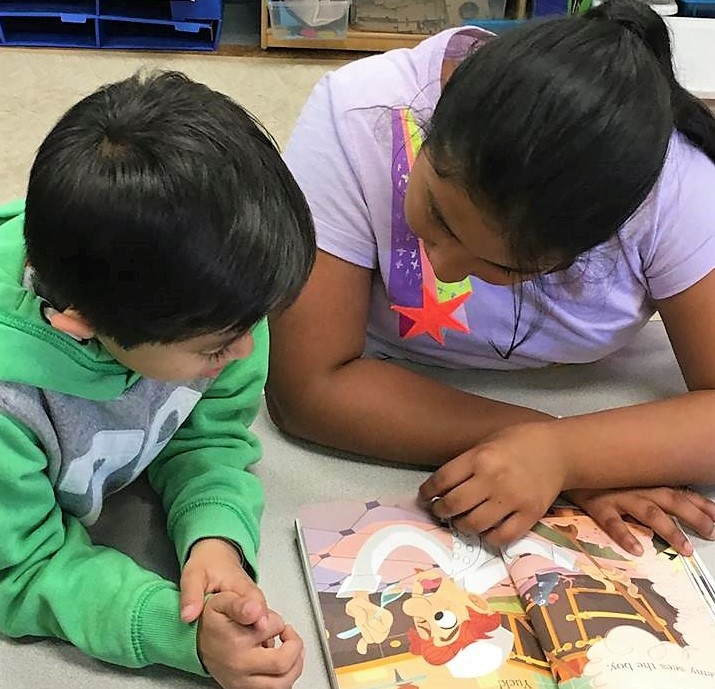Students read a book together