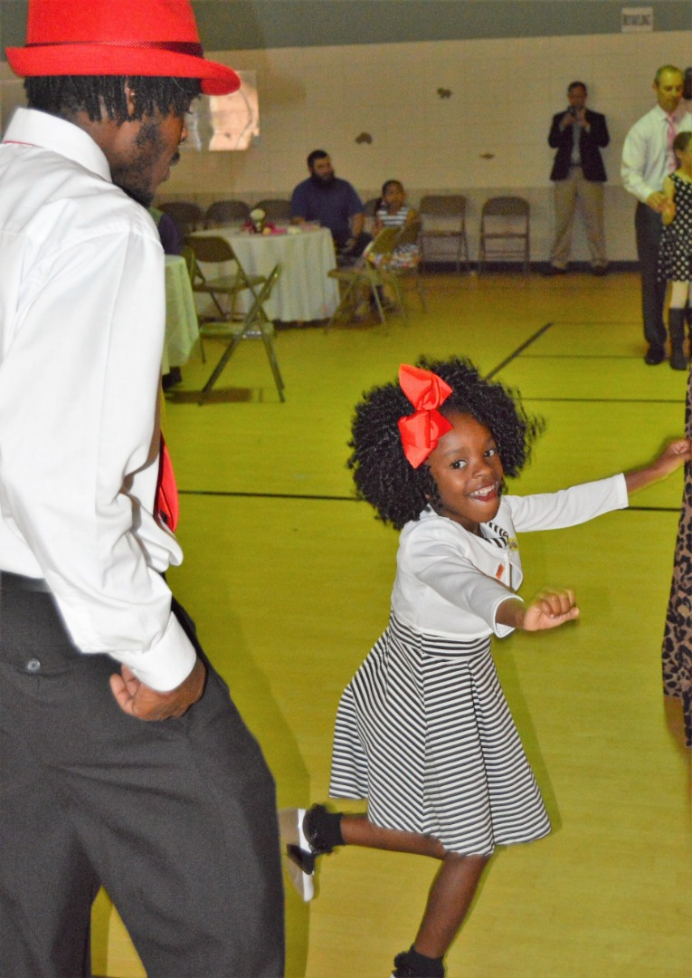 Prek girls shows dad how dancing is done