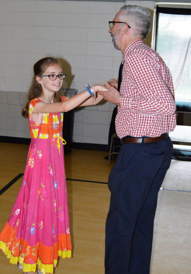 3rd grade girl and dad dance