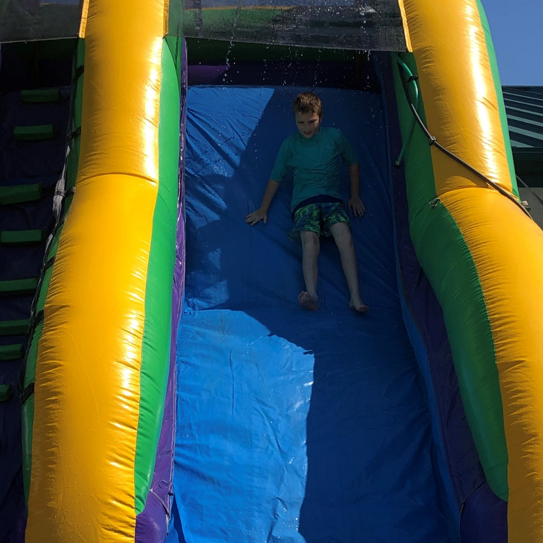 boy goes down the slide
