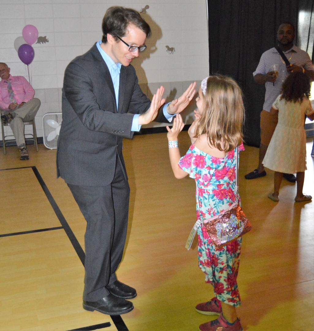 2nd grader with dad dancing