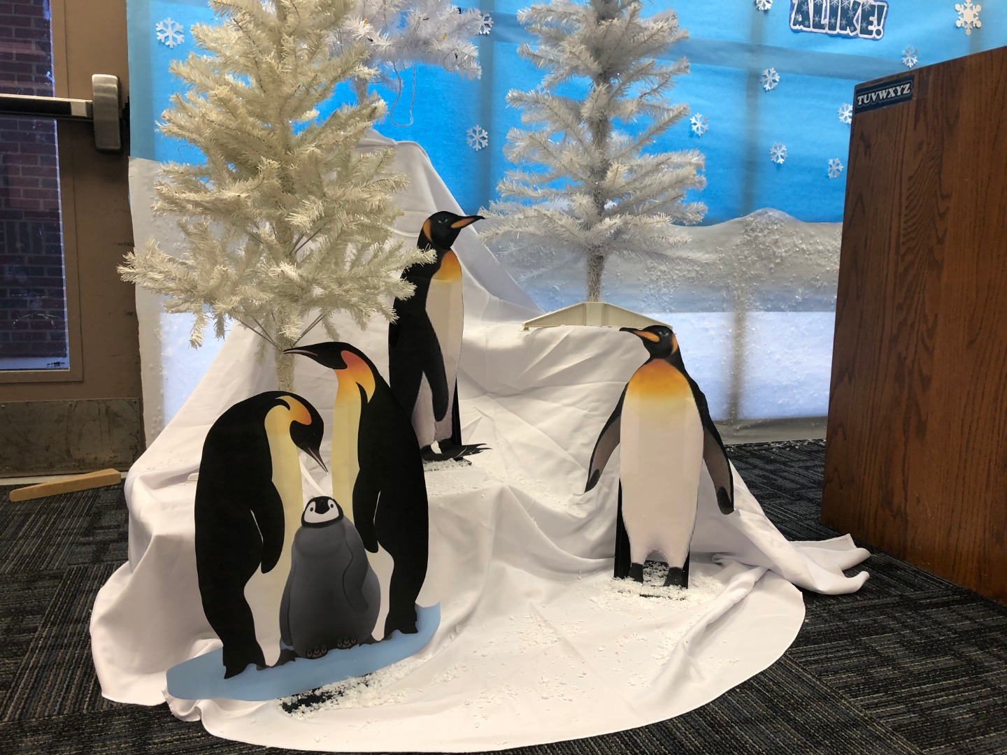 penguins with books