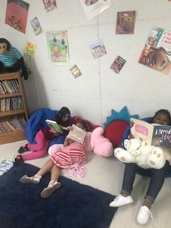 girls reading on pillows