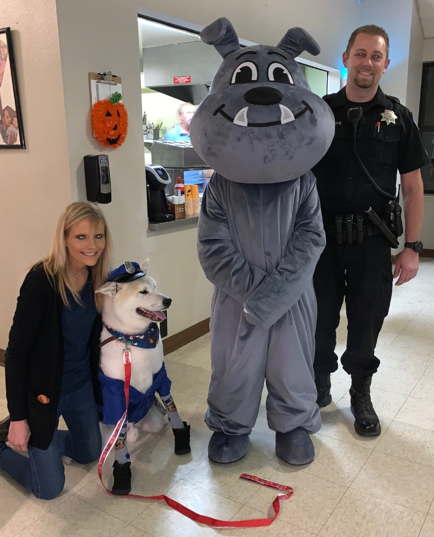 Ryan Baillie of the Martinez Police, Marty Martinez the mascot, Samantha Walker  & her therapy dog