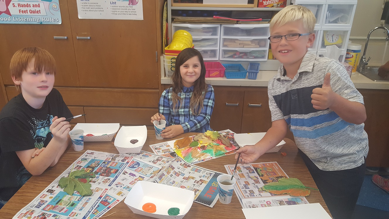 students painting leaves for art prints