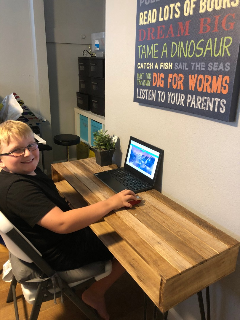 student sitting at desk at home during distance learning