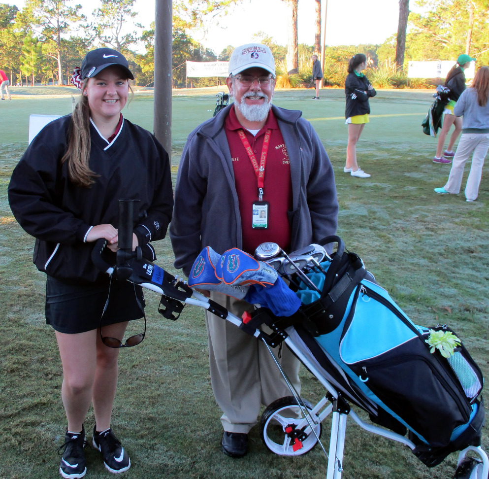 Golf student and coach