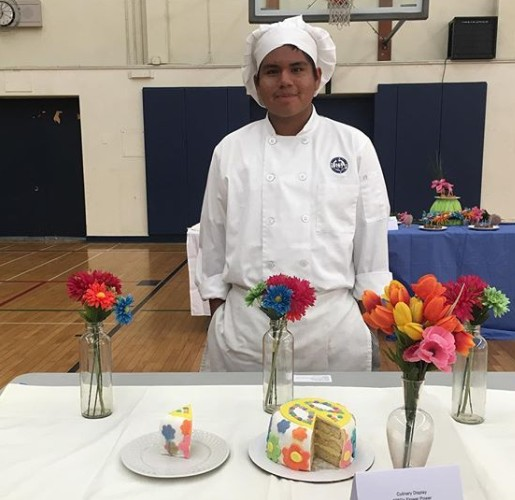 student in chef attire