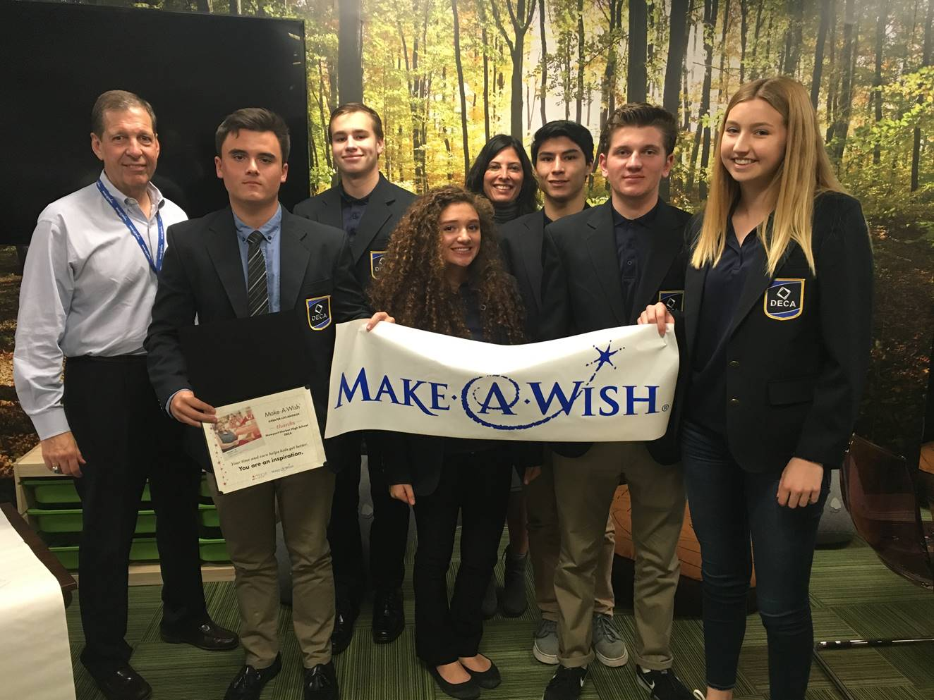 students holding make a wish poster
