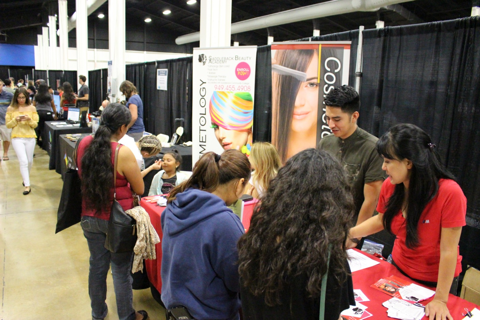people engaged at a booth