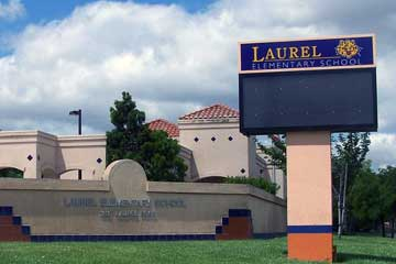 Laurel School front view of building, sign and fence