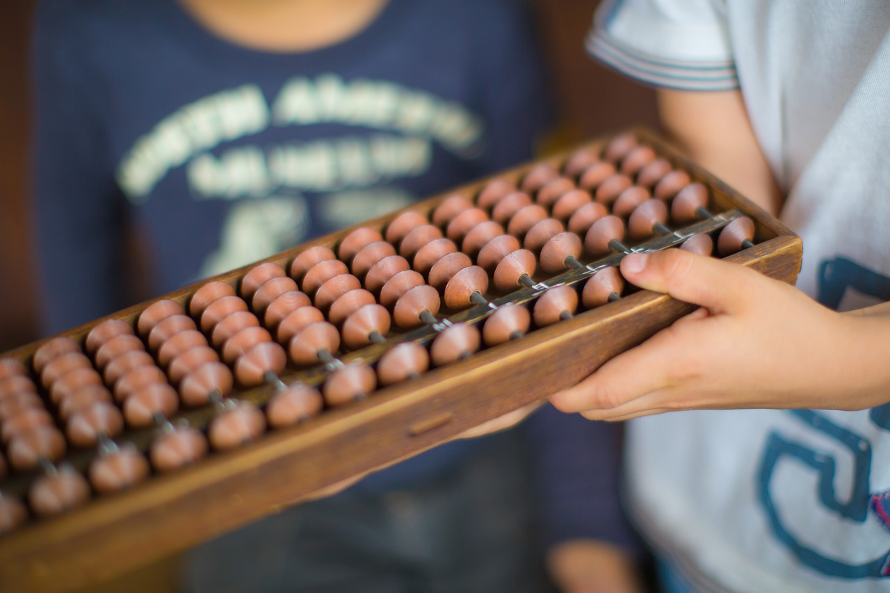 child holding abacus