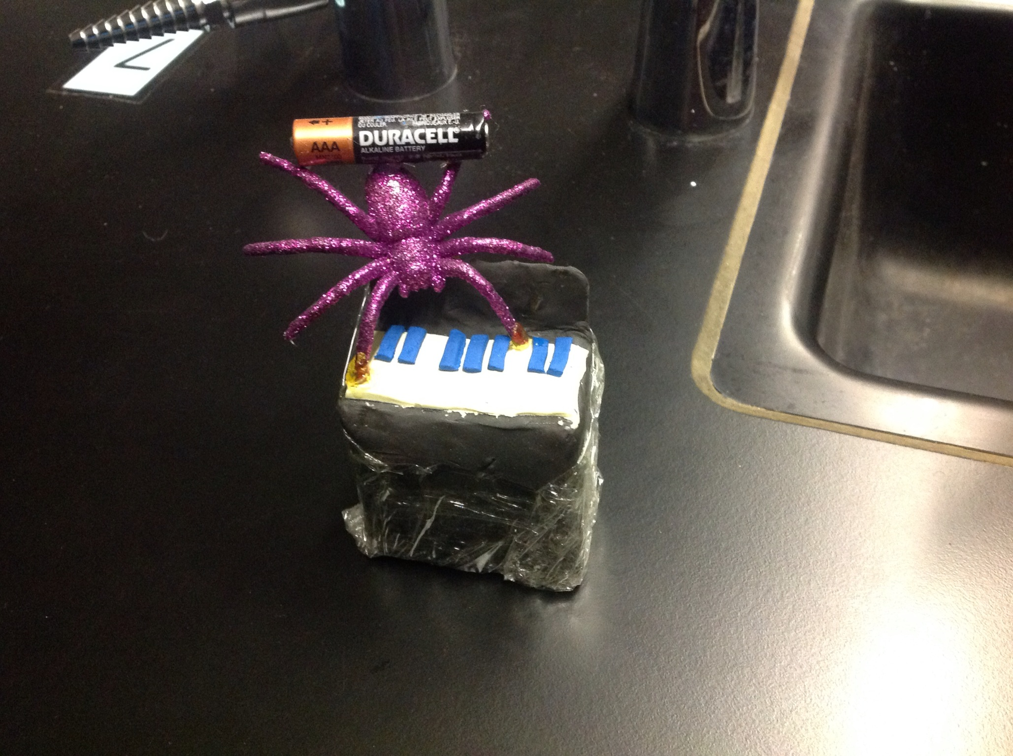 a battery wearing, piano playing spider