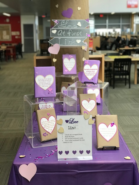 Book Display with wrapped books displaying the first line of the book in a  heart.