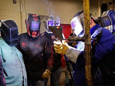Welding instructor and students