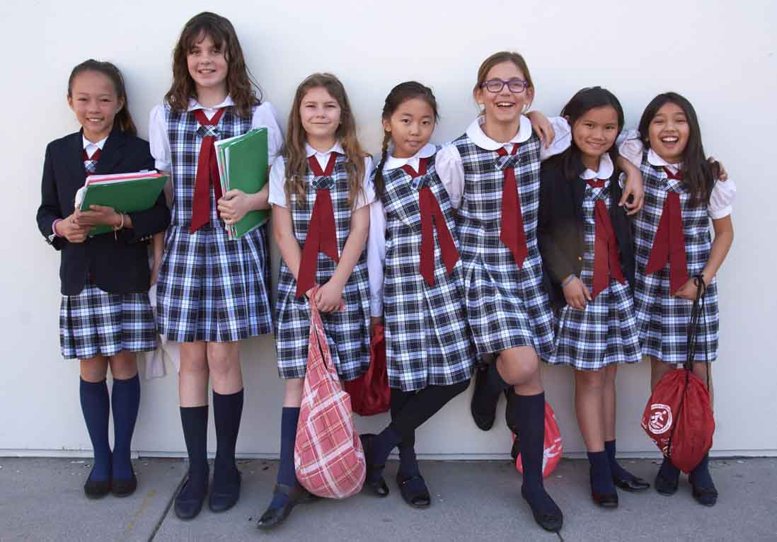 group of girls in school uniform